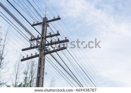 old electricity pole with blue sky and cloud background #469438787