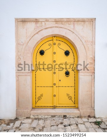 Old, elegant entrance to the house. Tunisian doors