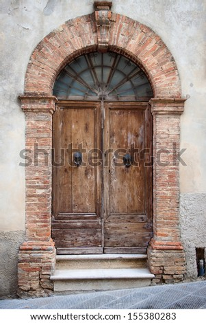 Old elegant wooden door in italian vilage
