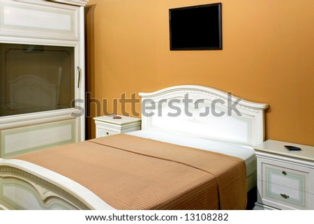 Old empty bedroom with big bed and closet