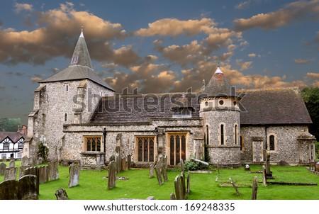 stock-photo-old-english-church-and-grave-yard-169248335.jpg