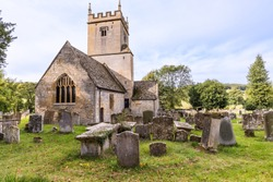 Old English Church and Graveyard in Cotswolds of England