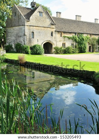 Old English Manor House Surrounded by a Moat