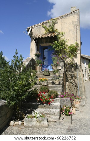 Old entrance and stairs with blue door, Provence, France - stock photo