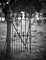 Old entrance gate and graves in an ancient church graveyard