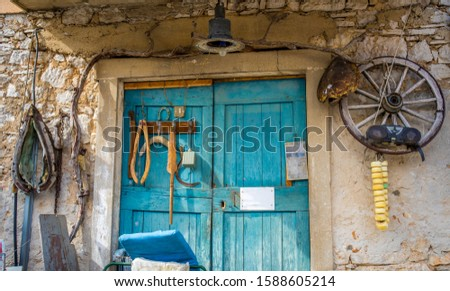 Old entrance to an old house with old objects hanging on the wall