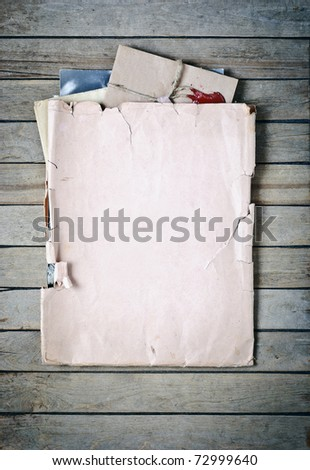 Old envelope with papers a on wooden planks background