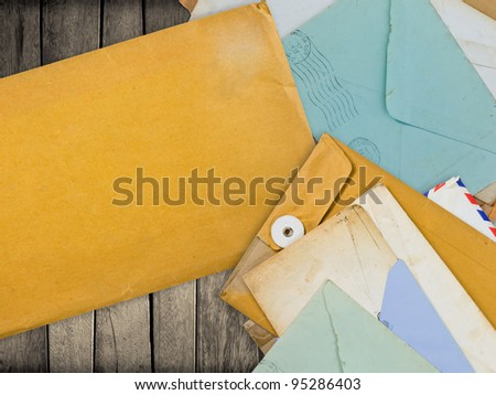 old envelopes on wood with space for contact information or others