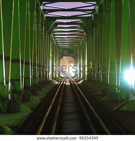 stock-photo-old-european-green-railway-bridge-at-night-90354349.jpg