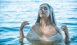 Old European magic, Mystical Pagan scene, woman in lake, rituals. Magic divination in water, ritual.