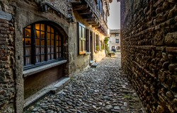 Old European narrow paved street. Pavement narrow street. Pavement street. Narrow pavement street