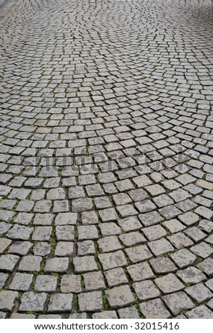Old European pavement with cobblestones