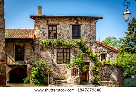 Old european stone house exterior view. Stone cottage house. Stone house exterior. Cute stone cottage house