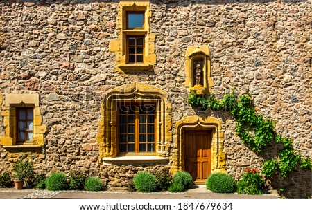 Old european stone house exterior view. Stone house entrance. Fairytale stone cottage house entrance. Stone cottage house from fairytale