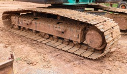 Old excavator trackhoe rusting in thailand.