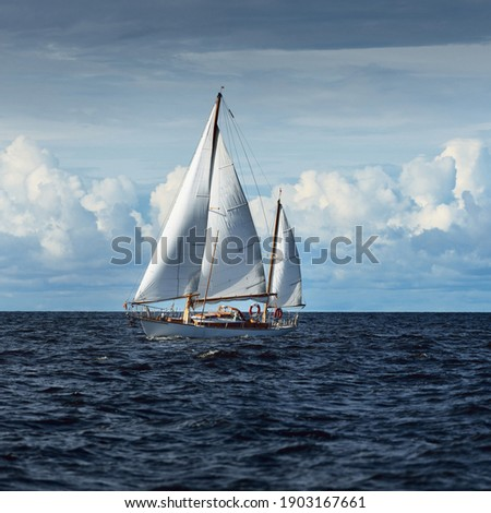Old expensive vintage two-masted sailboat (yawl) close-up, sailing in an open sea. Coast of Maine, US. Sport, cruise, tourism, recreation, leisure activity, transportation, nautical vessel Photo stock ©