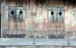 Old Exterior Wall With Wooden Doors In New Orleans French Quarter