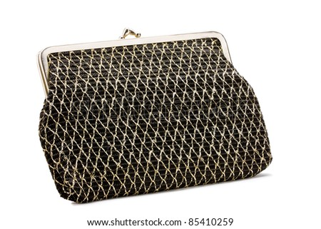 Old Fabric clutch purse  with gold diamond stitch pattern - stock photo