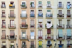 Old facade house. Old style windows with balcony, detail of some windows and balcony. Barcelona. Spain