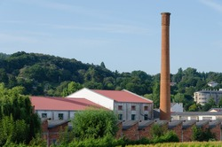 old factory chimney in an industrial plant. Town of Sarria, Lugo, Galicia, Spain