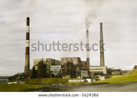 Old factory in russia. harmful pollution obsolete technology.