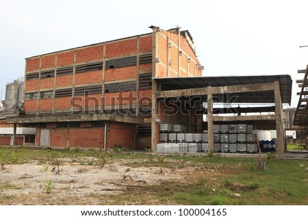 old factory industrial building built with red brick structure - stock photo