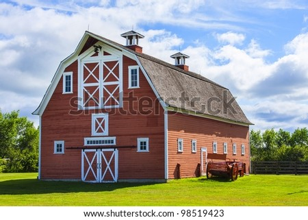 Old fading red barn on a farm