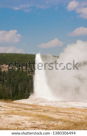 old faithful Geyser in old faithful Basin in Yellowstone National Park in Wyoming #1380306494