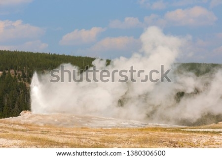 old faithful Geyser in old faithful Basin in Yellowstone National Park in Wyoming #1380306500
