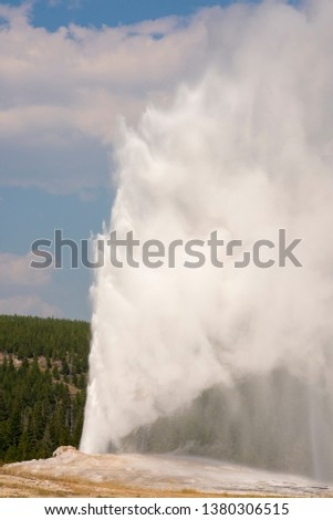 old faithful Geyser in old faithful Basin in Yellowstone National Park in Wyoming #1380306515