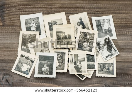 old family photos on wooden...