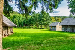 Old Farm Barn, Cottage, Bathhouse, and Field. Countryside Architecture. Rustic Wooden Buildings in Village.
