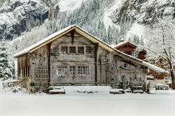 Old farm barn in the Snow in Lauterbrunnen, Switzerland