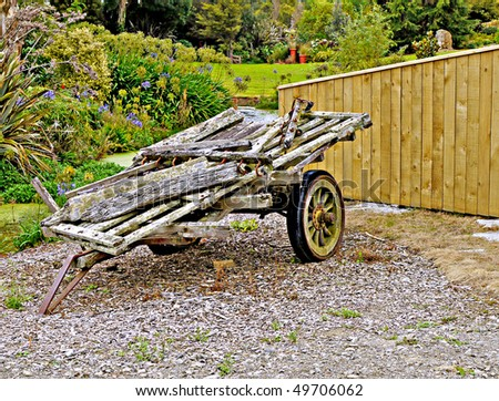 Old farm cart used as feature at home entrance