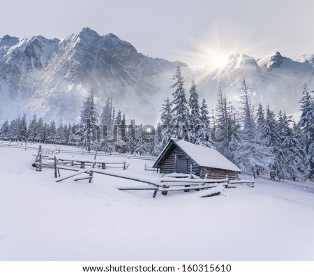 Old farm in the mountains. Foggy winter morning.