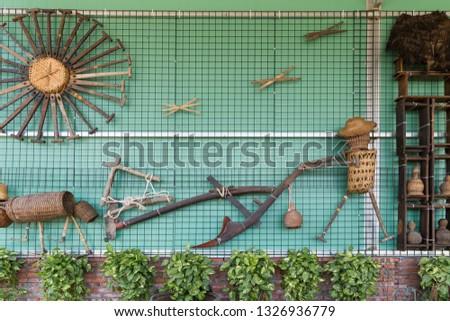 Old farm tools displayed at Shunde Xindi Farm #1326936779