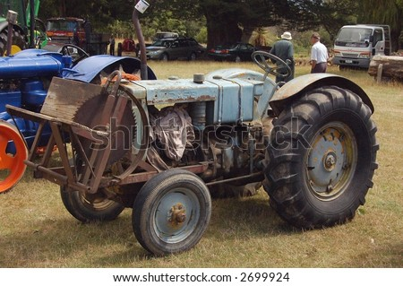 old farm tractor with saw blade attached