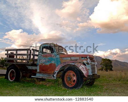 Old farm truck in sunset
