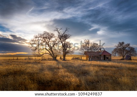 Old Farmhouse at Sunset on the Great Plains #1094249837