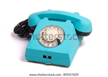 old fashion blue phone isolated on white with round dialing