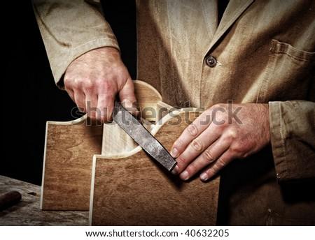 old fashion craftsman at work fine closeup detail background - stock photo