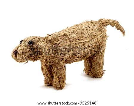 stock-photo-old-fashion-fanny-hand-made-toy-straw-dog-9525148.jpg