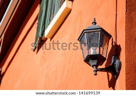 old-fashion lamp hanging on brick wall - stock photo