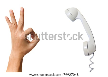 Old fashion phone with OK hand sign isolated on white background