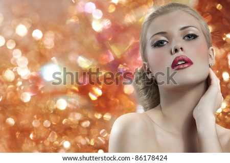 old fashion portrait of a young beautiful blond woman with hair style and deep red yellow lips on black background