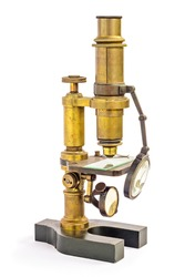 Old fashion (retro, vintage) brass microscope isolated on white background