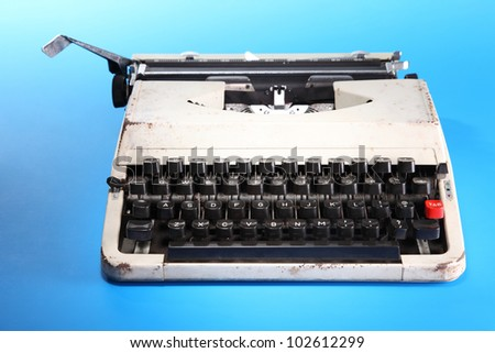 old fashion typewritter on the blue background