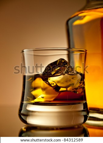 Old fashion whiskey on the rocks - stock photo
