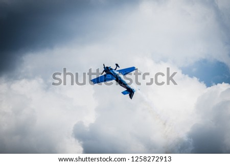 Old fashioned airplane mid-barrel roll