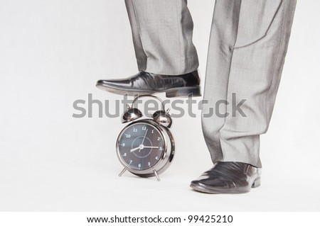 Old fashioned alarm clock and businessman